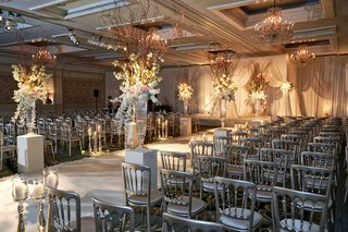 jewish-wedding-ceremony-at-hotel-in-chicago-with-silver-chair-white-flower-branch-details-rustic