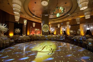 clock-and-monogram-projections-for-new-years-eve-wedding