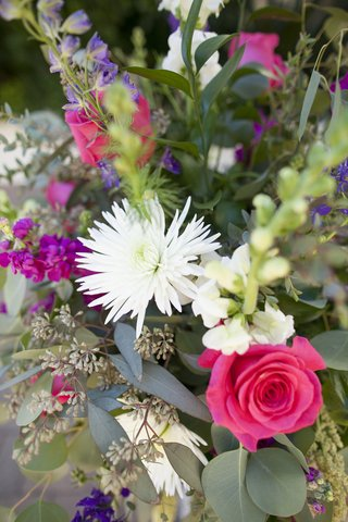 colorful-floral-centerpiece-white-spider-mum-pink-rose-purple-flowers-greenery