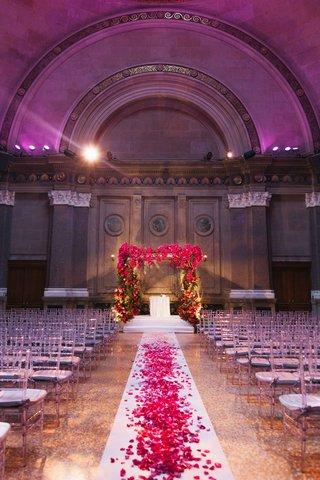 clear-chiavari-chairs-at-weylin-b-seymours-venue-with-floral-chuppah-and-flower-petal-aisle