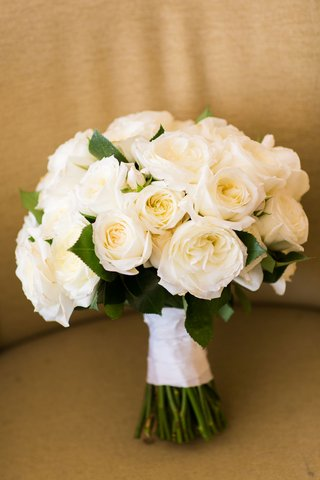 white-rose-ivory-rose-flowers-wrapped-with-white-ribbon-green-stems-exposed