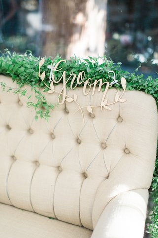 love-seat-for-sweetheart-table-with-gold-groom-sign