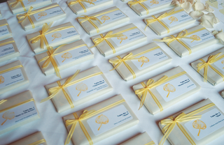 small-white-box-and-escort-card-tied-with-yellow-ribbon