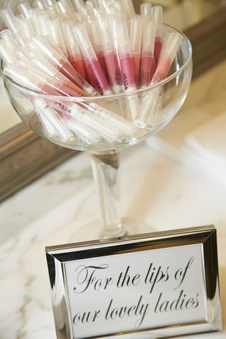 sign-in-silver-frame-with-bowl-of-stila-lipstick