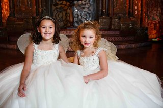 flower-girls-in-sleeveless-white-dresses-by-matthew-christopher-with-wings