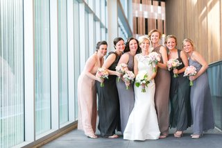 bride-with-bridesmaids-in-grey-blue-and-tan-dresses