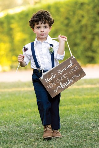 ring-bearer-in-navy-pants-and-suspenders-with-mickey-mouse-lollipop-wood-sign-uncle-here-comes-bride