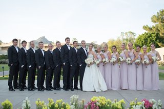 bride-in-strapless-anne-barge-dress-groom-in-tuxedo-bridesmaids-in-long-lavender-dresses