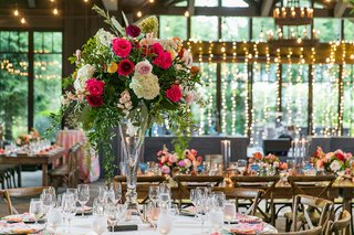 colorful-wedding-reception-decor-twinkle-lights-view-of-outside-trees-greenery-wood-chairs-tables