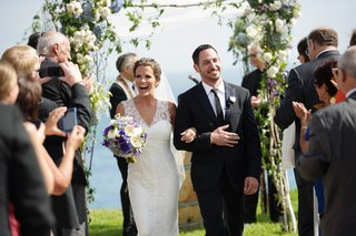 melissa-claire-egan-and-groom-walk-up-aisle-as-husband-and-wife