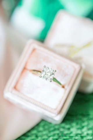 bridal-engagement-ring-yellow-gold-band-solitaire-princess-cut-diamond-four-prong-in-light-pink-box