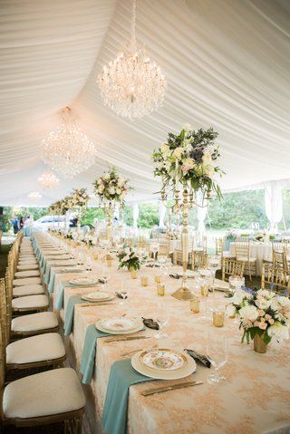 blush-and-white-linens-blue-napkins-tented-reception-chandelier-gold-chiavari-chairs