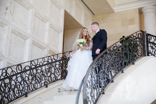 bride-in-hayley-paige-ball-gown-with-tulle-skirt-with-nude-lined-bodice-groom-in-suit-staircase