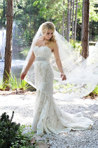 bride-in-a-strapless-lace-anne-barge-gown-with-beaded-belt-and-veil