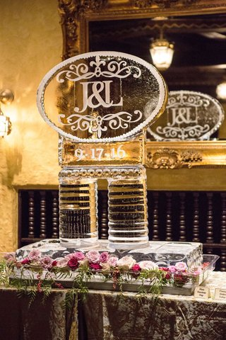 wedding-reception-ice-sculpture-with-flowers-greenery-pink-roses-wedding-date-and-monogram