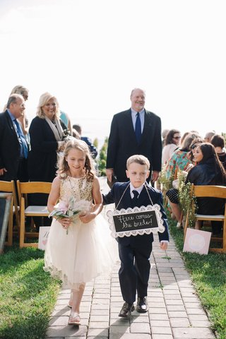 flower-girl-and-ring-bearer-with-diy-chalkboard-wedding-sign
