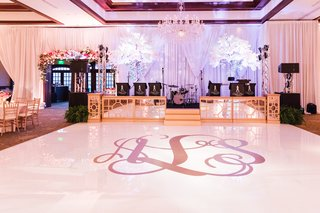 wedding-reception-white-dance-floor-with-giant-golden-monogram