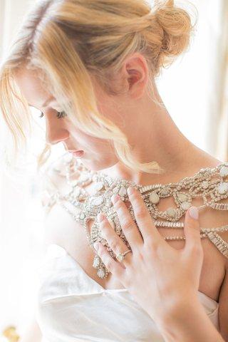 bride-in-hayley-paige-wedding-dress-with-crystal-bolero-sweetheart-neckline-blonde-curly-hair-updo