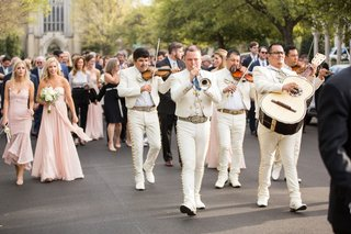 wedding-guests-walking-streets-with-mariachi-band-inspired-by-san-miguel-de-allende-callejoneada