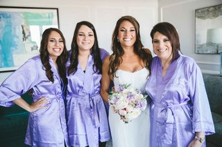 bride-in-monique-lhuillier-intrigue-bridesmaids-and-mother-of-the-bride-in-lavender-robes