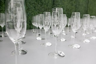 custom-champagne-glasses-with-monogram-and-each-guests-name-etched-in-with-mirror-tags-on-stem