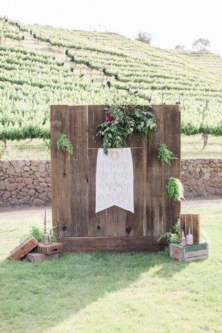 reception-signage-calligraphy-wooden-wall-california-boho-chic-wedding-styled-shoot-greenery