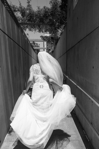 black-and-white-photo-of-a-bride-in-a-jenny-packham-dress-walking-to-the-cathedral