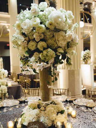 gold-glitter-vase-topped-with-white-flowers