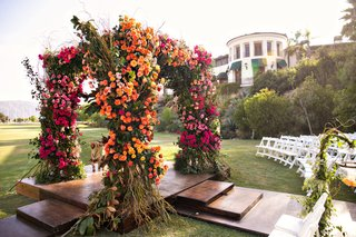 wedding-ceremony-wood-aisle-outdoor-chuppah-with-colorful-color-palette-pink-orange-flowers