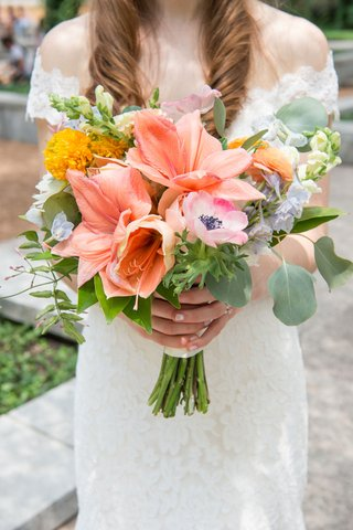 bride-in-off-the-shoulder-romona-keveza-wedding-dress-bouquet-with-pink-lilies-anemone-yellow-flower