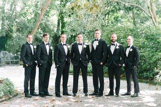 groom-groomsmen-classic-tuxes-black-south-carolina-wedding-south-boutonnieres-stylish-wedding