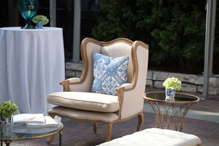 beige-seating-southern-inspired-wedding-tan-armchair-blue-and-white-pillow
