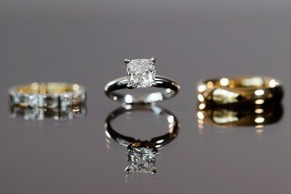 brides-solitaire-engagement-ring-four-prong-with-wedding-ring-and-grooms-gold-band