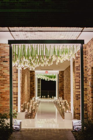 black-archway-with-upside-down-calla-lilies-to-enter-wedding-reception