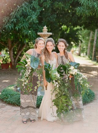 bride-with-sisters-braids-cascading-palm-frond-unique-bouquets-wedding-ideas-sequin-bridesmaid-dress