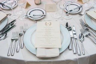 wedding-reception-menu-with-crested-monogram-on-cream-napkin-and-monique-lhuillier-charger