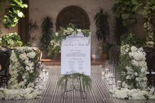 wedding-ceremony-sign-with-greenery-on-top-and-bottom