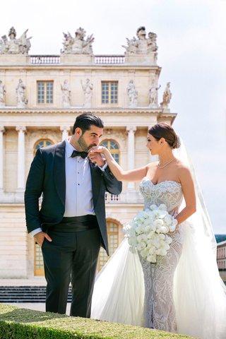 armenian-couple-groom-kisses-bride-on-hand-bride-in-leah-da-gloria-lace-wedding-dress-tulle
