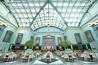 harold-washington-library-wedding-reception-skylight-neutral-decor-blue-runner-gold-details-gay-lgbt