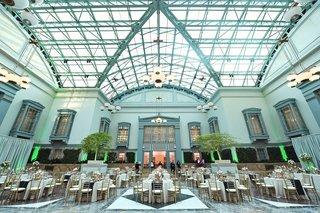 harold-washington-library-wedding-reception-skylight-neutral-decor-blue-runner-gold-details-gay-lgbt