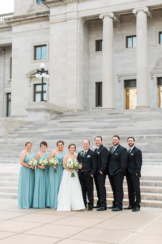 bride-in-justin-alexander-plain-ball-gown-bridesmaids-in-turquoise-after-six-dresses-groomsmen