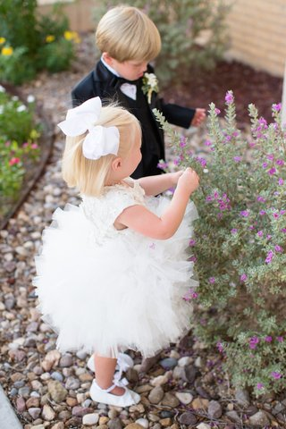 white-ruffle-flower-girl-dress-and-white-bow-and-ring-bearer-tux