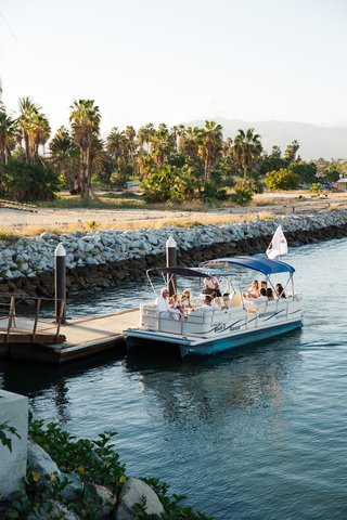 boat-bringing-guests-to-ceremony-location-at-destination-wedding-in-cabo-san-lucas