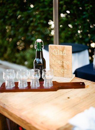 wedding-reception-cocktail-hour-wood-bar-with-flight-beer-wood-paddle-bottled-beer