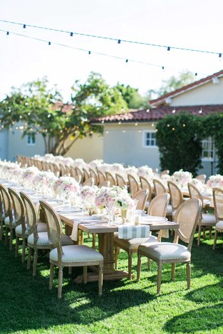the-inn-at-rancho-santa-fe-outdoor-wedding-reception-with-long-farm-tables-and-rustic-details