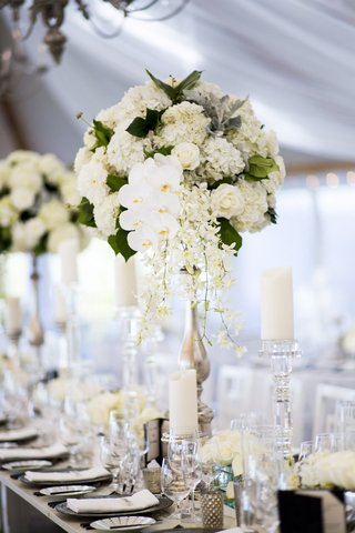 tall-floral-arrangement-white-blossoms-greenery-orchids-hydrangea-roses-chrome-scheme