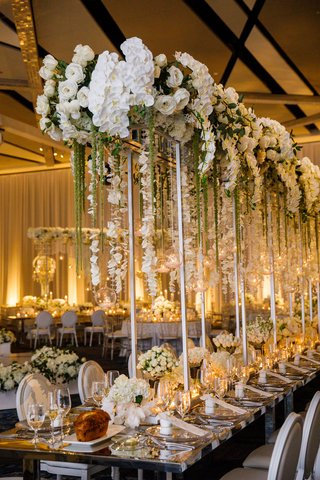 wedding-reception-tall-silver-riser-white-rose-orchid-flowers-amaranthus-glass-orb-candlelight-tulip