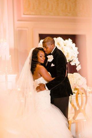 bride-in-strapless-mermaid-gown-with-veil-long-hair-groom-in-tuxedo-velvet-white-gold-reception