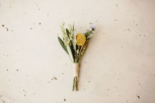 wedding-boutonniere-wrapped-with-twine-yellow-lavender-greenery-leaves