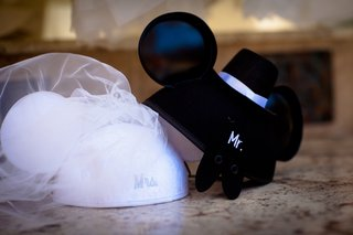 grooms-mickey-mouse-ears-with-top-hat-and-brides-minnie-mouse-ears-with-veil